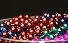 Free Christmas Colored Beads In A Cup Stock Images - 1354494