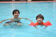 Free Man & Boy In The Pool Royalty Free Stock Images - 1355969