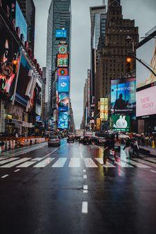 Free Man Crossing On Pedestrian Lane At Time Square, New York Royalty Free Stock Image - 135065496
