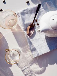 Free Whit Ceramic Teapot On Towel Near Spoon Royalty Free Stock Photo - 135337955