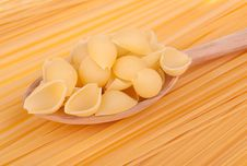 Italian Pasta In A Wood Spoon Stock Photo