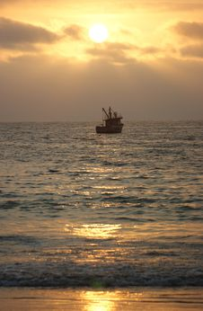 Free Boat At Sunset Royalty Free Stock Photos - 13549978