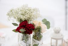 Free Selective Focus Photography Of Red Carnation Flowers, White Hybrid Tea Rose Flowers, And Baby S Breath Flowers In Jar Stock Photos - 135444943