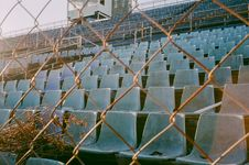 Free Cyclone Wire And Empty Chairs Royalty Free Stock Photography - 135445097