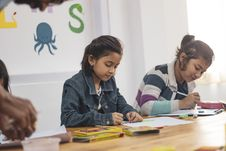 Free Two Girls Doing School Works Stock Images - 135445214