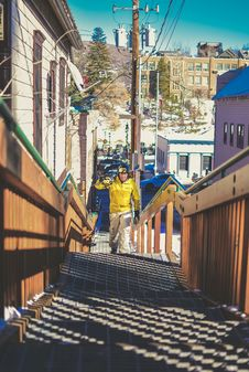 Free Man In Yellow Jacket Climbing Stairs Stock Photos - 135445263