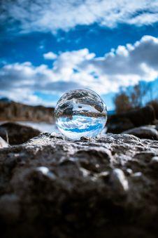 Free Lensball On Gray Stone Stock Photo - 135496850
