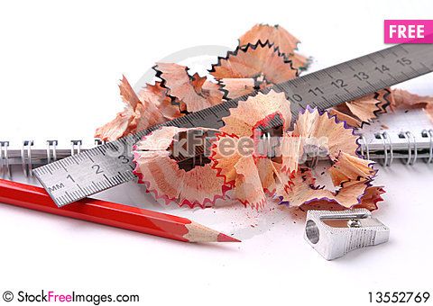 Open spiral notebook with pencil and sharpener. Stock Photo