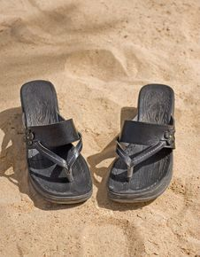 Free Pair Of Sandals On The Beach Stock Photos - 13550423