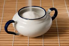 Free A White Enamel Sugar Bowl Being Filled Royalty Free Stock Photo - 13551135
