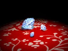 Free Diamonds On A Red Tissue Royalty Free Stock Image - 13551686