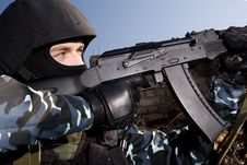 Soldier Shooting With Rifle From The Hideout Stock Image