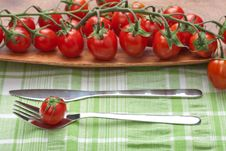 Tomatoes Fork And Knife Stock Images