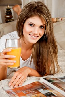 Young Beauty Woman With A Glass Of Orange Juice Royalty Free Stock Photo