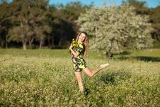 Beautiful Young Woman Jumping In Blooming Meadow Royalty Free Stock Photography