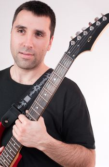 Free Young Man With Electric Guitar, Smiling Royalty Free Stock Photo - 13556815