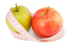 Free Pink Measuring Tape And Two Apples Royalty Free Stock Photography - 13558457
