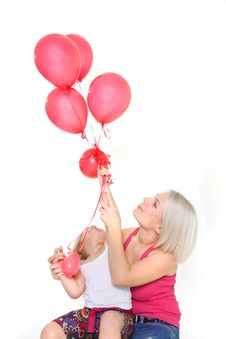 Mother And Daughter With Red Balloons Royalty Free Stock Photos