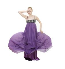 Young Beautiful Woman In Long Purple Dress Royalty Free Stock Photos
