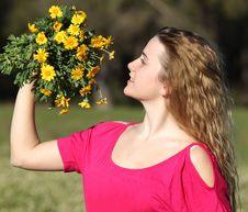 Free Beautiful Young Woman Standing In Blooming Meadow Stock Photography - 13559832