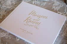 Free Morgan And Ronnie Guest Book On White Mesh Textile Stock Photography - 135538922