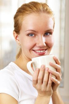 Free Young Smiling Woman With A Cup Stock Photo - 13560550