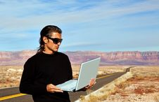 Man On Road With Laptop Royalty Free Stock Photography