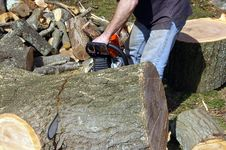 Free Man Cutting Log Stock Photo - 13561690