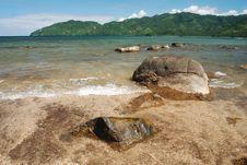 Rocks On A Serene Beach Stock Image