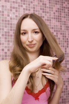 Girl Combs Hair Stock Image