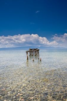 Decayed Jetty In A Lake Blue Skies Clear Water Wit Stock Photo
