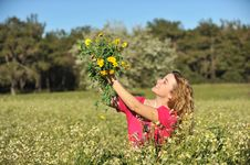 Free Beautiful Young Woman Standing In Blooming Meadow Stock Photo - 13567080