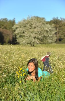 Free Beautiful Young Woman Lying In Blooming Meadow Royalty Free Stock Photo - 13567125