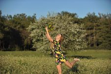 Beautiful Young Woman Jumping In Blooming Meadow Stock Photos