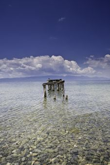 Decayed Jetty In A Lake Blue Skies Clear Water Wit Royalty Free Stock Images