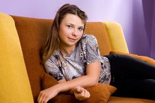 Free Girl Resting On The Couch Stock Photo - 13569200