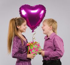 Boy, Girl And A Balloon Stock Images