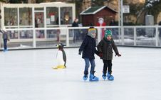 Free Two Children Inside Of Ice Skating Field Royalty Free Stock Photography - 135668637