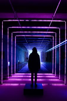 Free Silhouette Photo Of Person Standing In Neon Lit Hallway Royalty Free Stock Images - 135668659