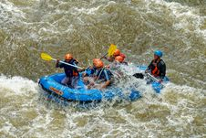 Free Group Of Men Paddling While Inside Inflatable Boat Stock Images - 135668814