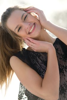 Free Happy Young Female Smiling While Outdoors Royalty Free Stock Images - 13573729