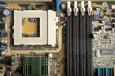 Free Motherboard PCB View To Memory And CPU Plugs Royalty Free Stock Photography - 13574417
