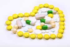 Free Heart Of Yellow Tablets Stock Images - 13575084