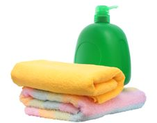 Free Green Plastic Bottle And Two Towels. Stock Photo - 13578560
