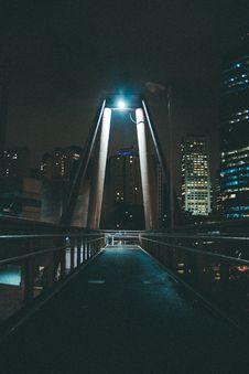 Free Gray Bridge Near City Buildings With Lights Turned Near At Night Royalty Free Stock Photos - 135770528