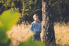 Free Boy Standing Beside Brown Tall Tree Stock Photo - 135770900