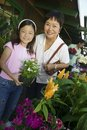 Free Grandmother And Granddaughter Holding Plant Stock Photos - 13583913