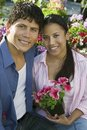 Free Couple Sitting Among Flowers Stock Images - 13583944