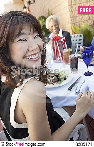 Smiling Woman having Lunch with friends Stock Photo
