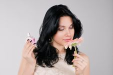 Free Beautiful Woman With Flower And  Perfume. Royalty Free Stock Images - 13582419